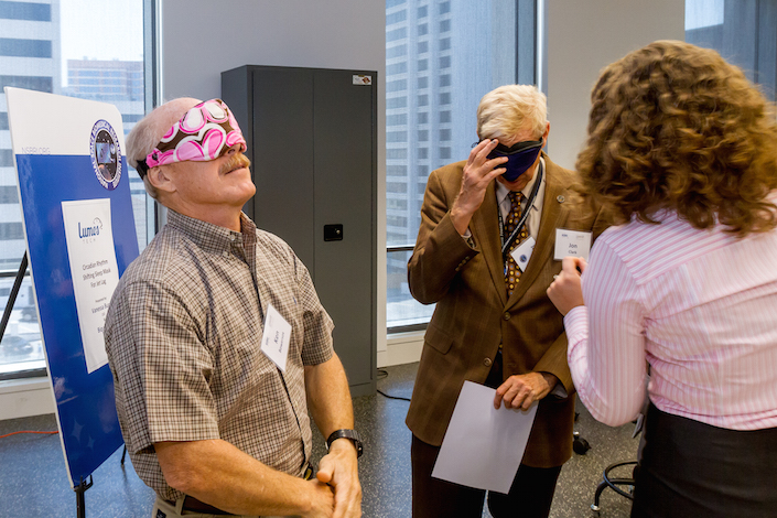 Commander Ken Bowersox, ret., tests the fit of a LumosTech smart sleep mask.