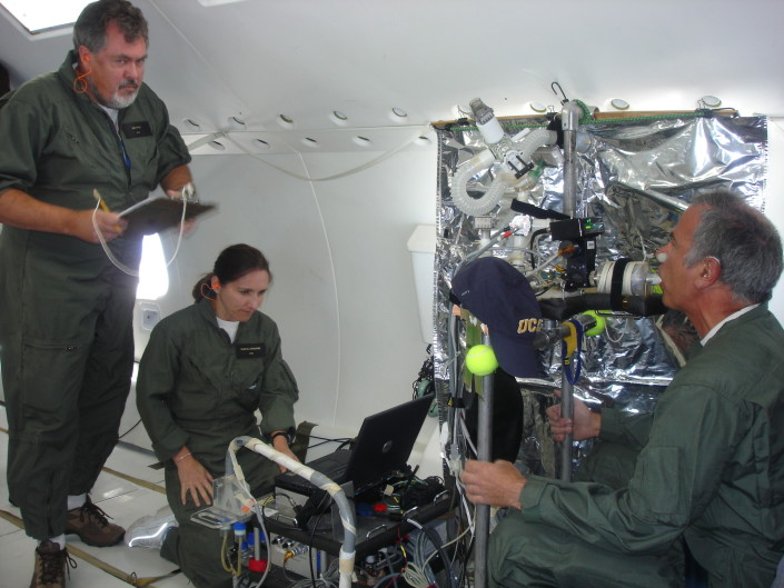 Dr. Kim Prisk (left) and Dr. Chantal Darquenne (center) measure aerosol deposition in Jeff Struthers' lungs during a lunar gravity portion of a Reduced Gravity Flight for an experiment funded by the National Space Biomedical Research Institute. Prisk's research team is seeking to determine how moon dust acts in the human lungs and its health risks to astronauts.