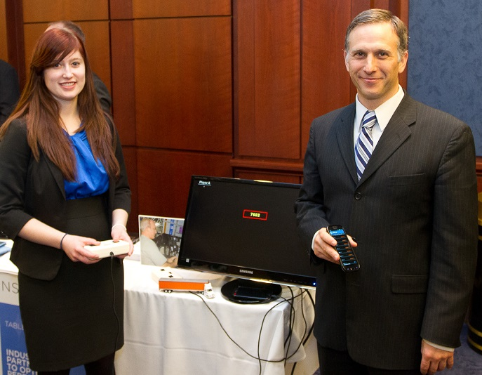 Rachel Bartells and the CEO of Pulsar Informatics, Inc., Dr. Daniel Mollicone, demonstrate SleepFit, an app based on the alertness test currently used by astronauts on the ISS and adapted for long-haul truck drivers and other shift workers on Earth.